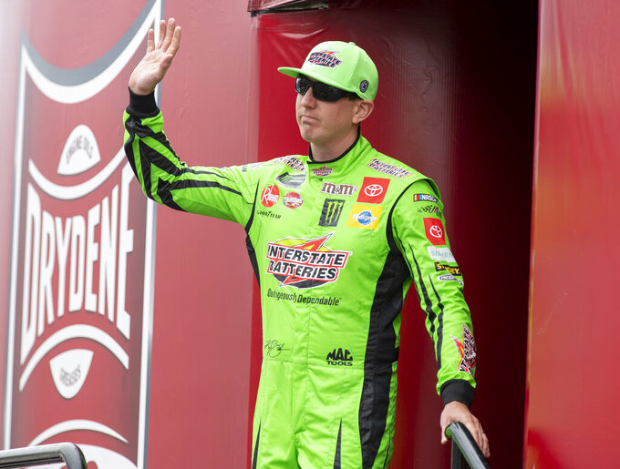 Kyle Busch No. (18) walks on to the stage during driver introductions at the Drydene 400 - Monster Energy NASCAR Cup Series playoff auto race, Sunday, Oct. 6, 2019, at Dover International Speedway in Dover, Del. (AP Photo/Jason Minto)