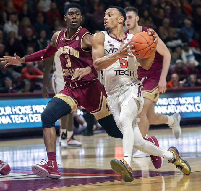Virginia Tech guard Justin Robinson (5) drives to the basket against Boston College guard Jared Hamilton (3) during the second half of an NCAA college basketball game Saturday, Jan. 5, 2019, in Blacksburg, Va. Tech won 77-66. (AP Photo/Don Petersen)