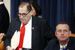House Judiciary Committee Chairman Rep. Jerrold Nadler, D-N.Y., left, and ranking member Rep. Doug Collins, R-Ga., arrive for a House Judiciary Committee markup of the articles of impeachment against President Donald Trump, on Capitol Thursday, Dec. 12, 2019, in Washington. (AP Photo/Alex Brandon)