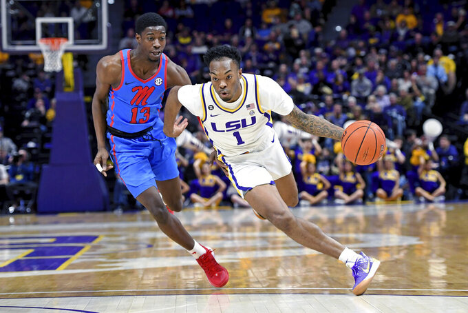 LSU guard Javonte Smart (1) drives to the basket as Mississippi guard Bryce Williams (13) gives chase in the first half of an NCAA college basketball game, Saturday, Feb. 1, 2020, in Baton Rouge, La. LSU won 73-63. (AP Photo/Bill Feig)
