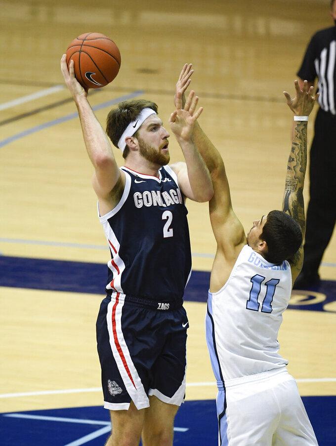 Gonzaga forward Drew Timme (2) shoots over San Diego forward Yavuz Gultekin (11) during the first half of an NCAA college basketball game Thursday, Jan. 28, 2021, in San Diego. (AP Photo/Denis Poroy)