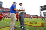 South Dakota State head coach John Stiegelmeier, left, talks with Iowa State head coach Matt Campbell before the NCAA college football game, Saturday, Sept. 1, 2018, in Ames, Iowa. (AP Photo/Matthew Putney)