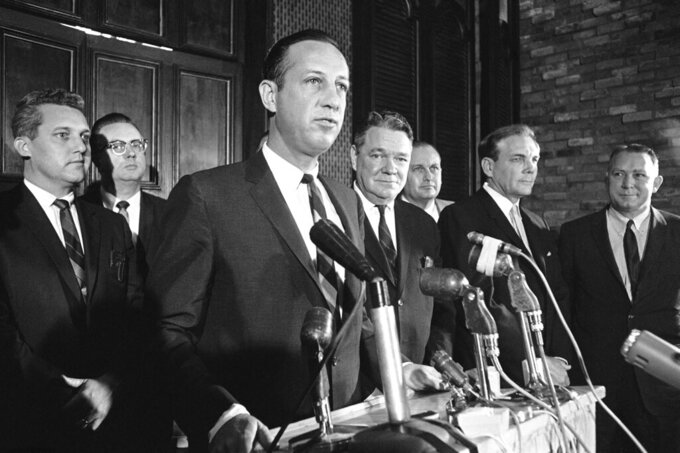 FILE - In this Nov. 1, 1966, file photo, NFL Commissioner Pete Rozelle, left, announces that New Orleans has been awarded the league's 16th franchise during a news conference in New Orleans. Under Rozelle, there were two strikes and three other work stoppages, though only the strikes affected the regular season. And, to be fair, Rozelle was not involved in negotiations with the union, then led by Ed Garvey; the NFL's management council had full authority. (AP Photo, File)