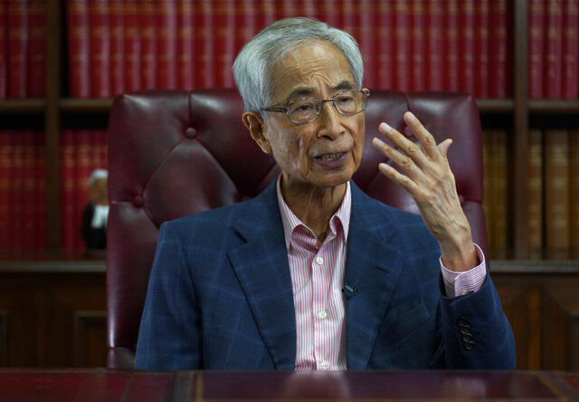 Pro-democracy lawyer Martin Lee gestures during an interview in Hong Kong, Friday, June 19, 2020. Lee said Friday that Beijing was trying to wrest control of Hong Kong with the impending national security law, and urged people to protest peacefully without violence. (AP Photo/Vincent Yu)
