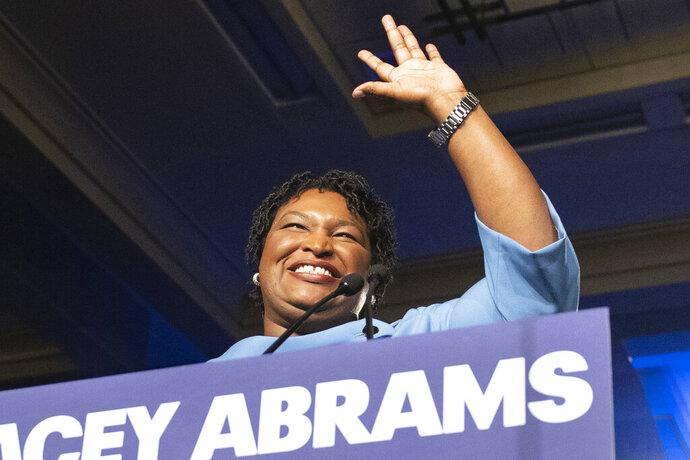 FILE - In this Nov. 6, 2018 file photo, former Georgia Democratic gubernatorial candidate Stacey Abrams speaks to supporters in Atlanta.  Abrams has gone from losing the Georgia governor's race to being a heavily recruited Democratic star. It's a dramatic rise often fueled by the promotional spending of Fair Fight Action, a nonprofit she founded to promote voting rights. They can accept unlimited sums of money, which could be a problem if she runs for office again. There is no proof of illegal activity. But donation limits could be applied retroactively to the group's spending if she runs for federal office.   (AP Photo/John Amis)