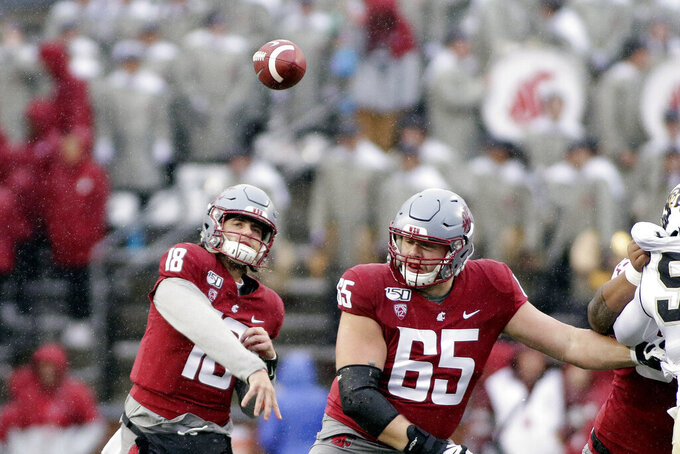 Washington State quarterback Anthony Gordon (18) throws a pass during the first half of an NCAA college football game against Colorado in Pullman, Wash., Saturday, Oct. 19, 2019. (AP Photo/Young Kwak)