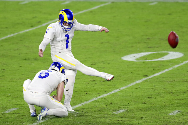 Los Angeles Rams' Matt Gay (1) kicks a field goal against the Tampa Bay Buccaneers during the second half of an NFL football game Monday, Nov. 23, 2020, in Tampa, Fla. Holding is Johnny Hekker (6). (AP Photo/Mark LoMoglio)