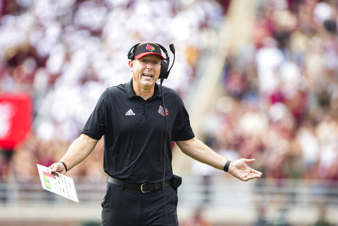 Louisville head coach Scott Satterfield questions a call in the first half of an NCAA college football game against Florida State in Tallahassee, Fla., Saturday, Sept. 25, 2021. (AP Photo/Mark Wallheiser)
