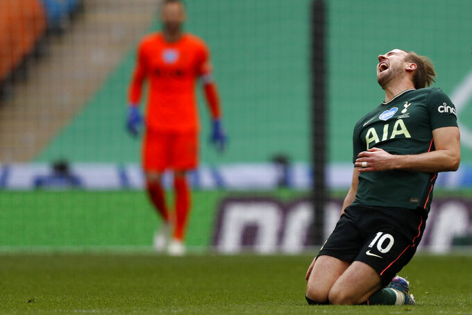 Tottenham's Harry Kane reacts after a tackle from Manchester City's Ruben Dias during the English League Cup final soccer match between Manchester City and Tottenham Hotspur at Wembley stadium in London, Sunday, April 25, 2021. (AP Photo/Alastair Grant)