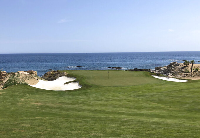 One of several holes appears at the Cabo Del Sol's Ocean Course along the Sea of Cortez in Cabo San Lucas, Mexico on Feb. 22, 2020. Cabo Del Sol and the other 17 courses at the tip of Baja California are coming back to life as the coronavirus pandemic begins to lessen. (AP Photo/John Marshall)
