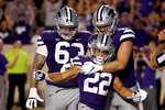 Kansas State running back Deuce Vaughn (22) celebrates with teammates after scoring a touchdown during the second half of an NCAA college football game against Southern Illinois, Saturday, Sept. 11, 2021, in Manhattan, Kan. Kansas State won 31-23 (AP Photo/Charlie Riedel)