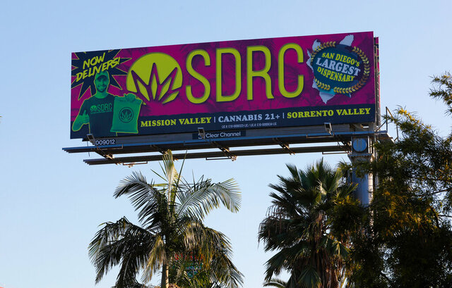 FILE - In this Jan. 13, 2020, file photo, a billboard in San Diego advertises a cannabis dispensary. The state Bureau of Cannabis Control on Thursday said billboard companies must stop selling space for cannabis marketing and take down existing ads on roads that cross state borders. The new regulation covers about three dozen state and interstate routes. (Nelvin C. Cepeda/The San Diego Union-Tribune via AP, File)