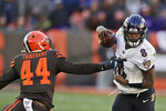 Baltimore Ravens quarterback Lamar Jackson (8) avoids a tackle by Cleveland Browns linebacker Sione Takitaki (44) during the second half of an NFL football game, Sunday, Dec. 22, 2019, in Cleveland. (AP Photo/Ron Schwane)