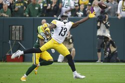 Pittsburgh Steelers' James Washington can't get to a p[ass in front of Green Bay Packers' Jaire Alexander during the first half of an NFL football game Sunday, Oct. 3, 2021, in Green Bay, Wis. (AP Photo/Mike Roemer)