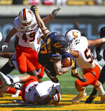 California wide receiver Vic Wharton III, center, is upended between Idaho State's Oshea Trujillo, bottom, Colton Belnap (49) and DJ Hagler, right, during the first half of an NCAA college football game Saturday, Sept. 15, 2018, in Berkeley, Calif. (AP Photo/Ben Margot)