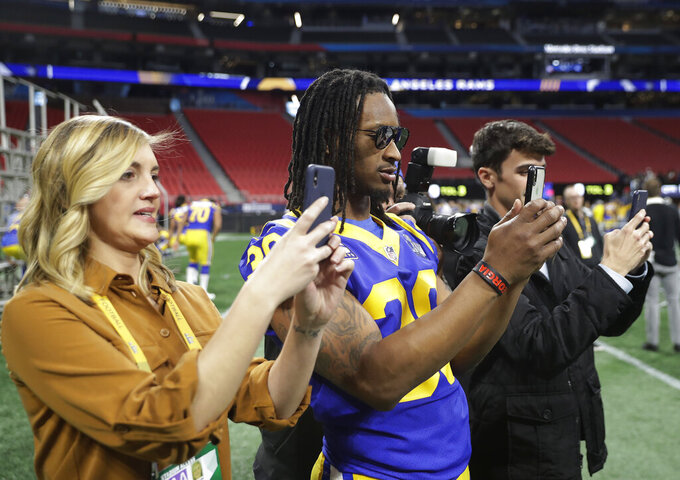 Los Angeles Rams running back Todd Gurley (30) photographs teammates during walkthrough at the Mercedes Benz Stadium for the NFL Super Bowl 53 football game against the New England Patriots, Saturday, Feb. 2, 2019, in Atlanta. (AP Photo/John Bazemore)