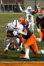 UTSA running back Brendon Brady, left, scores as Illinois linebacker Jake Hansen (35) defends during the first half of an NCAA college football game Saturday, Sept. 4, 2021, in Champaign, Ill. (AP Photo/Charles Rex Arbogast)