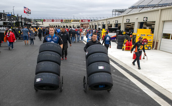 NASCAR teams move tires to their pit boxes before the Drydene 400 - Monster Energy NASCAR Cup Series playoff auto race, Sunday, Oct. 6, 2019, at Dover International Speedway in Dover, Del. (AP Photo/Jason Minto)