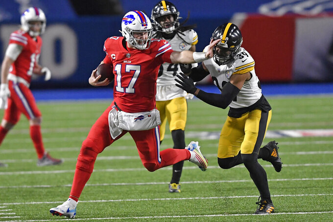 Buffalo Bills quarterback Josh Allen (17) stiff-arms Pittsburgh Steelers free safety Minkah Fitzpatrick (39) during the second half of an NFL football game in Orchard Park, N.Y., Sunday, Dec. 13, 2020. The Bills won 26-15. (AP Photo/Adrian Kraus)