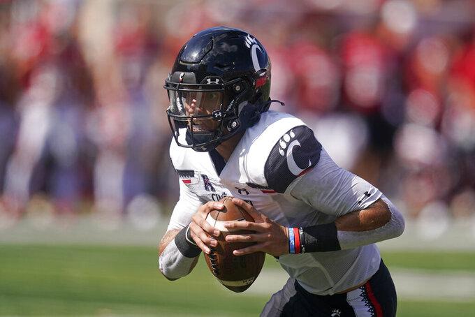 Cincinnati's Desmond Ridder (9) runs in for a touchdown during the second half of an NCAA college football game against Indiana, Saturday, Sept. 18, 2021, in Bloomington, Ind. Cincinnati won 38-24. (AP Photo/Darron Cummings)