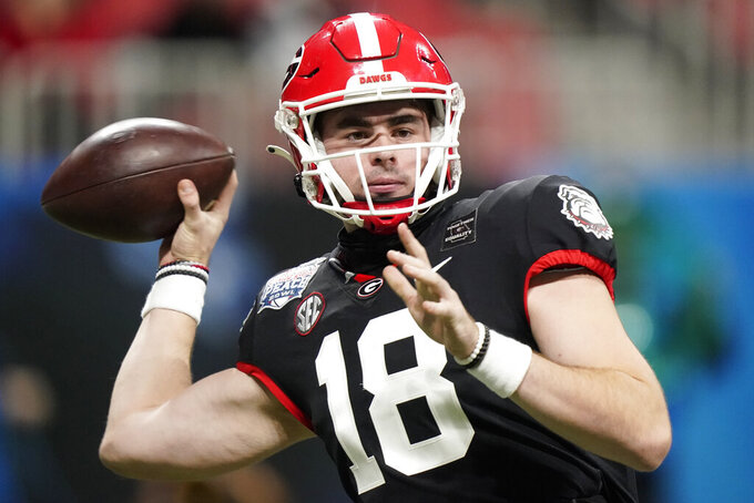 Georgia quarterback JT Daniels (18) works against Cincinnati during the first half of the Peach Bowl NCAA college football game, Friday, Jan. 1, 2021, in Atlanta. (AP Photo/Brynn Anderson)