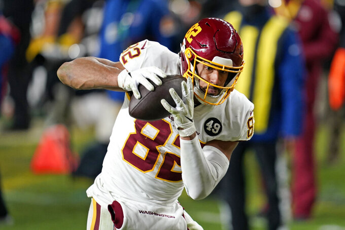 Washington Football Team tight end Logan Thomas (82) hauls in a 15-yard touchdown pass from quarterback Alex Smith during the second half of an NFL football game against the Pittsburgh Steelers, Monday, Dec. 7, 2020, in Pittsburgh. (AP Photo/Keith Srakocic)