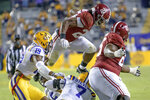 Alabama running back Najee Harris (22) leaps over LSU safety JaCoby Stevens (7) during the first half of an NCAA college football game in Baton Rouge, La., Saturday, Dec. 5, 2020. (AP Photo/Matthew Hinton)
