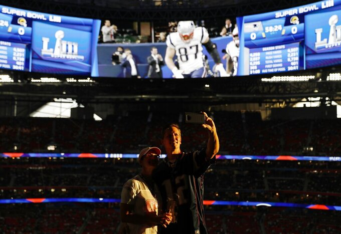 Shannon and Robin Holland take a self portrait before the NFL Super Bowl 53 football game between the Los Angeles Rams and the New England Patriots, Sunday, Feb. 3, 2019, in Atlanta. (AP Photo/David Goldman)