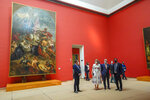 Belgium's King Philippe, center right, and Belgium's Queen Mathilde, center left, wear face masks, to prevent the spread of coronavirus, as they visit the Royal Museum of Fine Arts in Brussels, Tuesday, May 19, 2020. Museums are hesitantly starting to reopen as the coronavirus lockdown measures are relaxed, yet experts say that one in eight in the world could potentially face permanent closure because of the pandemic. (Daina Le Lardic, Pool Photo via AP)