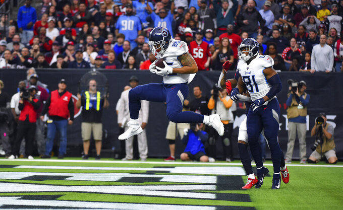 Tennessee Titans tight end MyCole Pruitt (85) catches a pass for a touchdown during the first half of an NFL football game against the Houston Texans Sunday, Dec. 29, 2019, in Houston. (AP Photo/Eric Christian Smith)