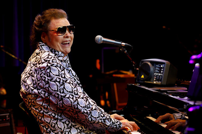 """In this Jan. 16, 2019 photo, Ronnie Milsap poses for a photo on the stage of The Ryman Auditorium in Nashville, Tenn. Milsap's new album, """"Ronnie Milsap: The Duets,"""" comes out on Friday. (Photo by Donn Jones/Invision/AP)"""