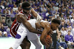 Oklahoma forward Kristian Doolittle (21) reaches in as TCU guard Jaire Grayer secures a rebound beneath the basket in the second half of an NCAA college basketball game in Fort Worth, Texas, Saturday, March 7, 2020. (AP Photo/Tony Gutierrez)