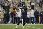 Seattle Seahawks quarterback Paxton Lynch starts to throw a pass against the Denver Broncos during the second half of an NFL football preseason game Thursday, Aug. 8, 2019, in Seattle. (AP Photo/Stephen Brashear)