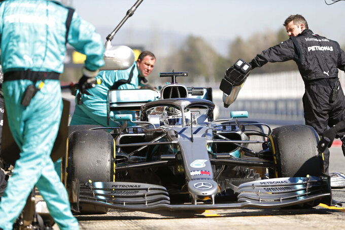 Mercedes driver Valtteri Bottas of Finland stops outside his team's pit garage during a Formula One pre-season testing session at the Barcelona Catalunya racetrack in Montmelo, outside Barcelona, Spain, Wednesday, Feb. 27, 2019. (AP Photo/Joan Monfort)