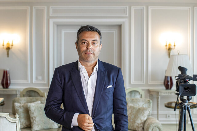 In this photo taken on Wednesday, Aug. 19, 2020, Leeds owner Andrea Radrizzani poses for a picture after an interview with the Associated Press in Lisbon, Portugal. Leeds is counting on Marcelo Bielsa leading the team in the Premier League while planning for a future without the enigmatic manager. In his second season in charge, the Argentine ended the team's 16-year exile from the world's richest league by gaining promotion as Championship winners before his contract expired last month. (AP Photo/Manu Fernandez)