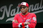 FILE- In this July 4, 2016, file photo,  Washington Nationals manager Dusty Baker (12) stands in the dugout before a baseball game against the Milwaukee Brewers at Nationals Park in Washington. A person with knowledge of the negotiations said Tuesday, Jan. 28,2 020, that Baker, 70,  is working to finalize an agreement to become manager of the Houston Astros. The person spoke on condition of anonymity because the deal has not yet been completed. (AP Photo/Alex Brandon, File)