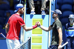 Russia's Karen Khachanov, left, shakes hands over the net with Norway's Viktor Durasovic after their ATP Cup tennis match in Perth, Australia, Tuesday, Jan. 7, 2020. (AP Photo/Trevor Collens)