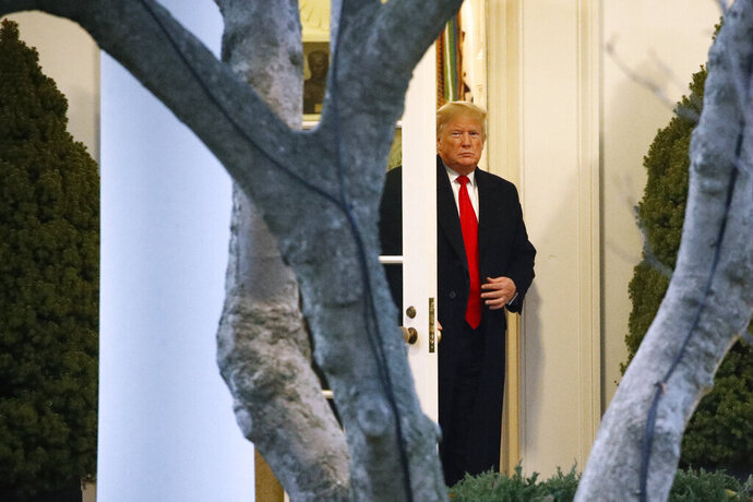 President Donald Trump leaves the Oval Office as he walks to Marine One on the South Lawn of the White House in Washington, Thursday, Nov. 14, 2019, for a short trip to Andrews Air Force Base, Md., and then on to Bossier City, La., for a campaign rally. (AP Photo/Patrick Semansky)