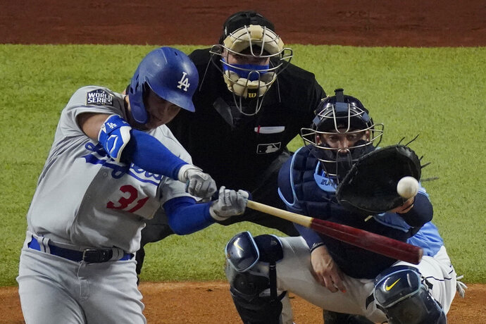 Los Angeles Dodgers' Joc Pederson hits home run against the Tampa Bay Rays during the second inning in Game 5 of the baseball World Series Sunday, Oct. 25, 2020, in Arlington, Texas. (AP Photo/Sue Ogrocki)