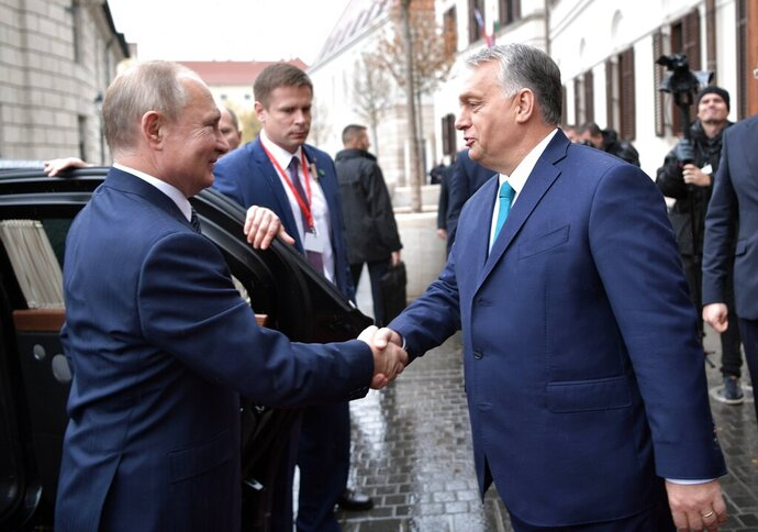 Hungarian Prime Minister Viktor Orban, right, greets Russian President Vladimir Putin upon his arrival in Budapest, Hungary, Wednesday, Oct. 30, 2019. Hungary has maintained friendly ties with Russia and long criticized the European Union's sanctions against Moscow. (Alexei Nikolsky, Sputnik, Kremlin Pool Photo via AP)