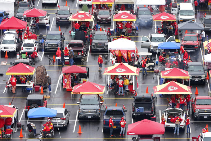 Fans tailgate outside Arrowhead Stadium before an NFL football game between the Kansas City Chiefs and the Houston Texans Thursday, Sept. 10, 2020, in Kansas City, Mo. (AP Photo/Charlie Riedel)