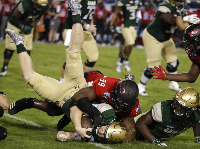 UAB quarterback Tyler Johnston III is tackled by Northern Illinois defensive tackle Ben LeRoy (99) during the second half of the Boca Raton Bowl NCAA college football game, Tuesday, Dec. 18, 2018, in Boca Raton, Fla. UAB won 37-13. (AP Photo/Lynne Sladky)