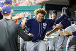 San Diego Padres' Josh Naylor celebrates in the dugout after hitting a solo home run off Cincinnati Reds starting pitcher Sonny Gray during the sixth inning of a baseball game Tuesday, Aug. 20, 2019, in Cincinnati. (AP Photo/John Minchillo)