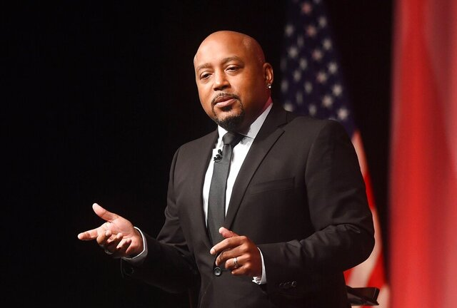 "FILE - Daymond John of ABC's Shark Tank speaks at the Manufacturer and Business Association's 113th Annual Event at the Bayfront Convention Center, Thursday, Oct. 4, 2018, in Erie, Pa. Lowe's is offering small businesses, particularly those owned by minorities, the ""Shark Tank"" treatment. The home improvement chain is teaming up with Daymond John to give potential suppliers the chance to pitch their products to a Fortune 500 company.( Jack Hanrahan/Erie Times-News via AP, File)"