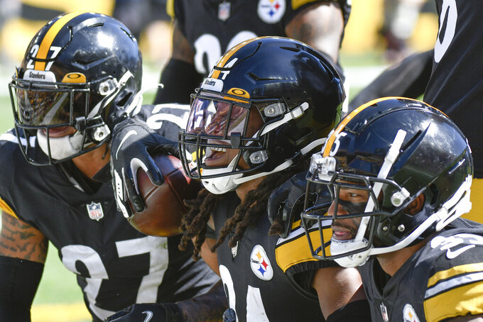 Pittsburgh Steelers strong safety Terrell Edmunds (34) celebrates with teammates after making an interception against the Cincinnati Bengals during the first half an NFL football game, Sunday, Sept. 26, 2021, in Pittsburgh. (AP Photo/Don Wright)