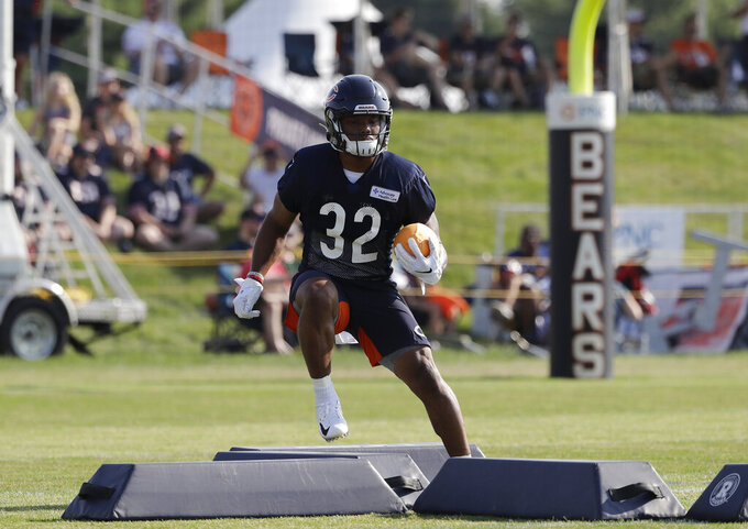 Chicago Bears running back David Montgomery works on the field during an NFL football training camp in Bourbonnais, Ill., Saturday, July 27, 2019. (AP Photo/Nam Y. Huh)