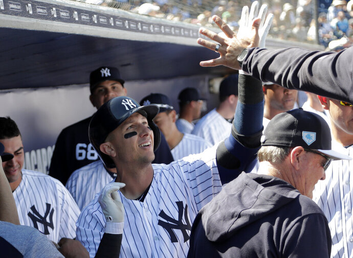 New York Yankees' Troy Tulowitzki celebrates in the dugout after hitting a solo home run in the first inning during a spring training baseball game against the Toronto Blue Jays, Monday, Feb. 25, 2019, in Tampa, Fla. (AP Photo/Lynne Sladky)