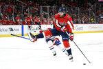 Washington Capitals center Evgeny Kuznetsov (92), of Russia, skates with the puck as Montreal Canadiens center Max Domi (13) defends during the first period of an NHL hockey game, Friday, Nov. 15, 2019, in Washington. (AP Photo/Nick Wass)