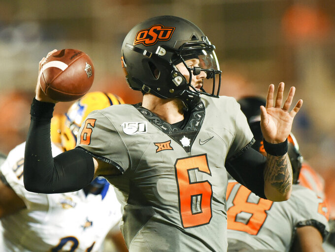 Oklahoma State quarterback Dru Brown looks to throw a pass during the second half of an NCAA college football game against McNeese in Stillwater, Okla., Saturday, Sept. 7, 2019. (AP Photo/Brody Schmidt)