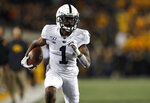Penn State wide receiver KJ Hamler runs the ball in for a touchdown during the first half of the team's NCAA college football game against Iowa on Saturday, Oct. 12, 2019, in Iowa City, Iowa. (AP Photo/Matthew Putney)